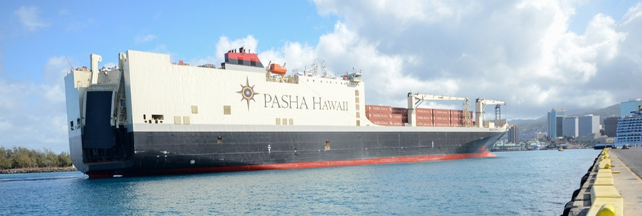 M/V Marjorie C entering Honolulu Harbor with numerous cars, trucks, vans, and shipping containers onboard.